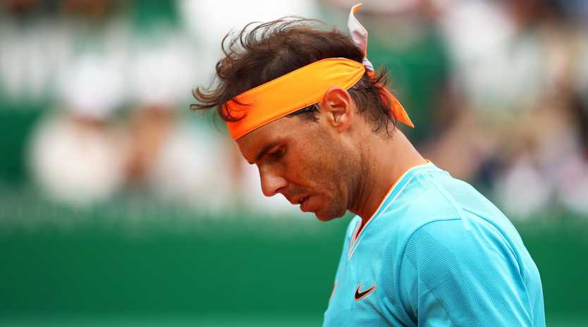 MONTE-CARLO, MONACO - APRIL 20: Rafael Nadal of Spain shows his frustration during his straight sets defeat by Fabio Fognini of Italy in their semifinal match during day seven of the Rolex Monte-Carlo Masters at Monte-Carlo Country Club on April 20, 2019 in Monte-Carlo, Monaco. (Photo by Clive Brunskill/Getty Images)