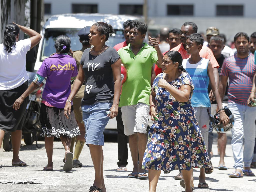 Relatives gather outside a hospital following blasts in Colombo, Sri Lanka. Picture: AP