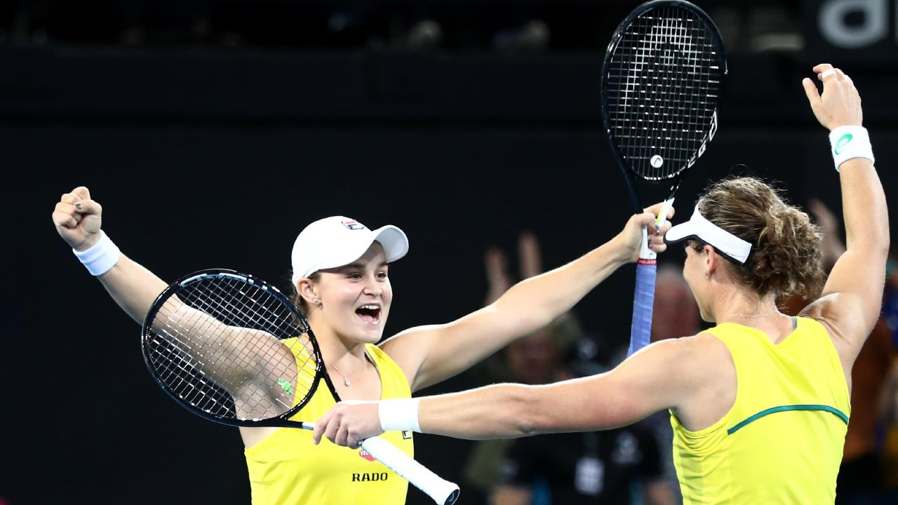 Barty and Sam Stosur celebrate their doubles victory. Picture: Chris Hyde/Getty Images