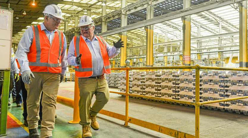UNCERTAIN: Prime Minister Scott Morrison   with member for Flynn Ken O'Dowd met workers at Boyne Smelters Limited during his visit to Gladstone  in   2018.