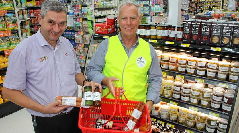 TASTY TREATS: Romeo from Cooroy IGA shows off some of his fresh fare to Jim from Cooroy Fusion Festival.