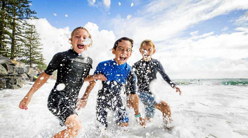 Caloundra locals Hunter Andersson, 9, Joey Silk, 8, and Taine Woodbry, 11, make the most of the king tides and Easter holidays at Moffat Beach.