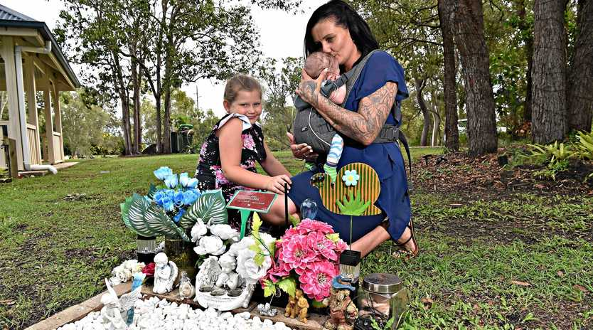 MUM'S HEARTACHE: Deanne Gillbee, pictured with daughter Ciarah, 9 and son Ryder, five months, is pleading for increased security at the Caloundra Cemetery after her son's grave was targeted by thieves for the second time.