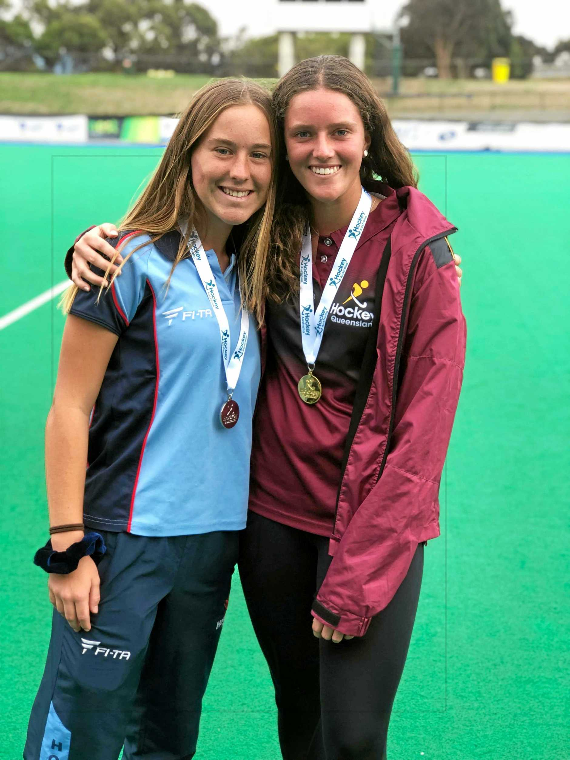 STERLING EFFORT: Ashleigh Ensbey (left) claimed silver against Kyra Livermore's Queensland in a hard-fought final of the 2019 Under-18 Women's Outdoor Championships in Hobart.