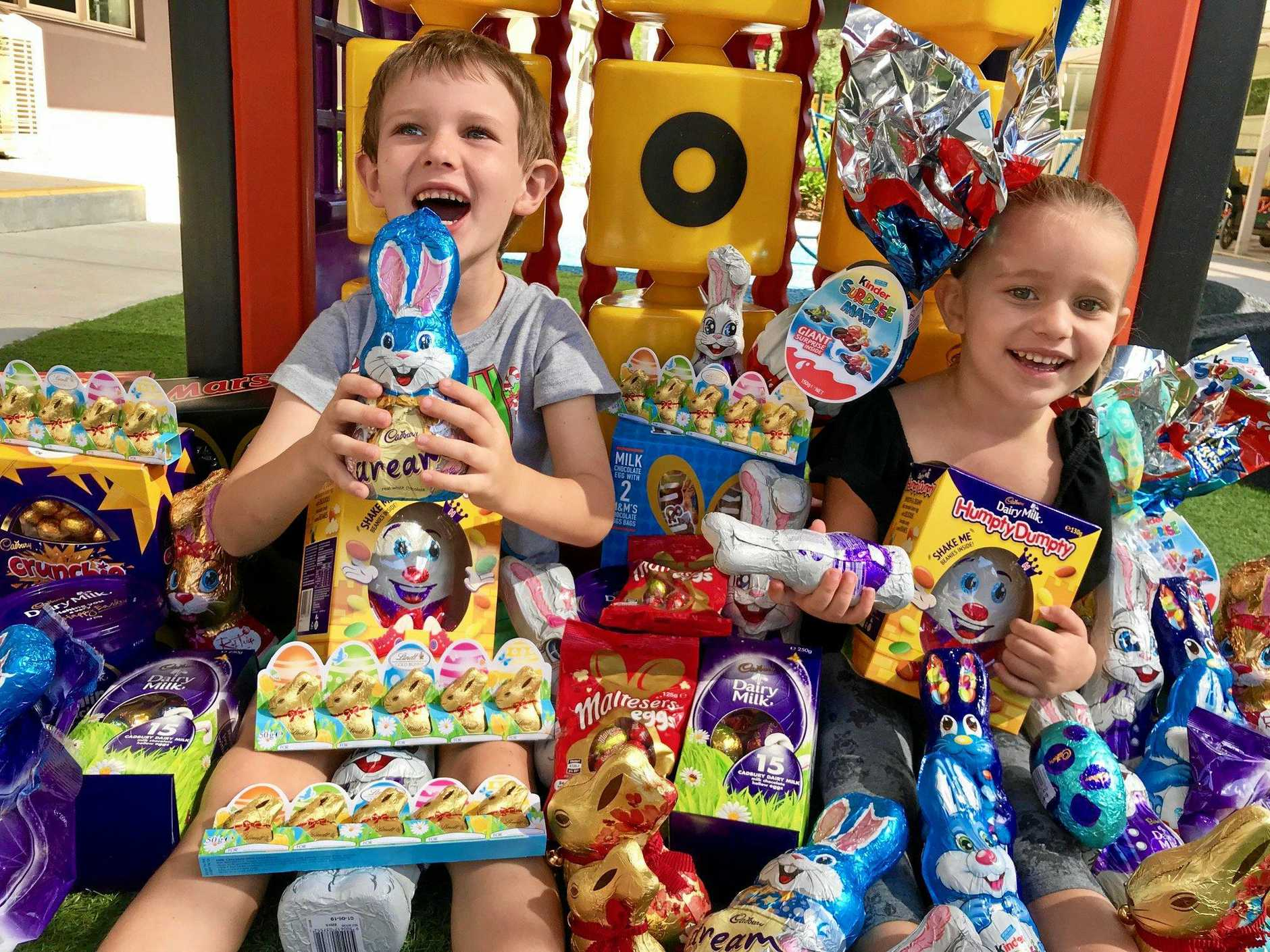 CHOCOLATE OVERLOAD: Zoltan, 5, and Arna-Marie, 3, Slatter were overcome with chocolate gifts at Ronald McDonald House North Queensland.