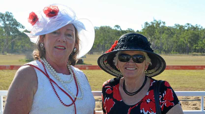 ANZAC POPPIES: Lesley Thun and Margaret Cross at the Anzac Day races in Wondai in 2018.