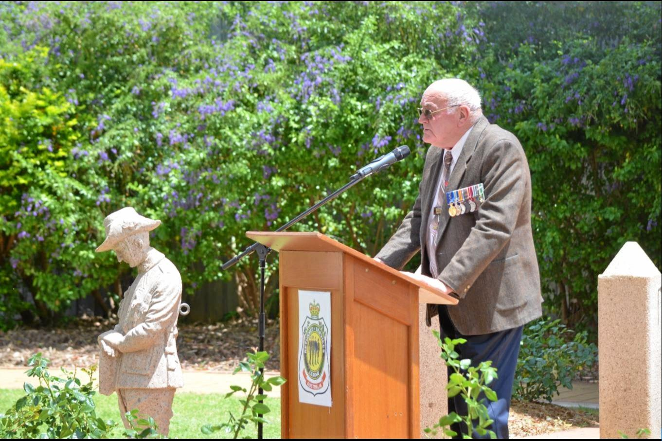 RSL sub-branch president George Donohue giving an address at a Remembrance Day service.