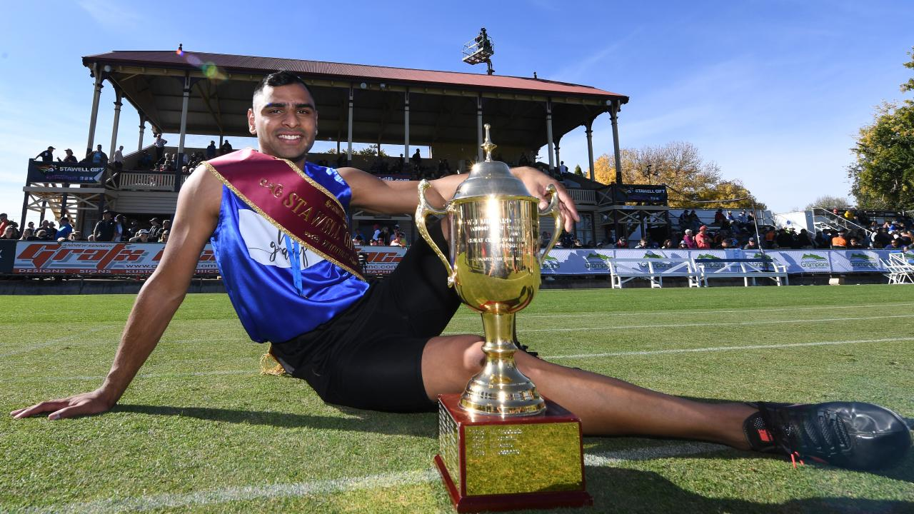 Dhruv Rodrigues Chico with the Stawell Gift trophy. Picture: AAP