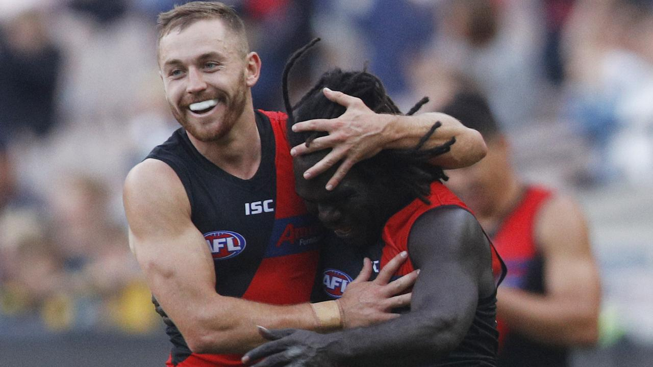 Anthony McDonald-Tipungwuti and Devon Smith of Essendon.
