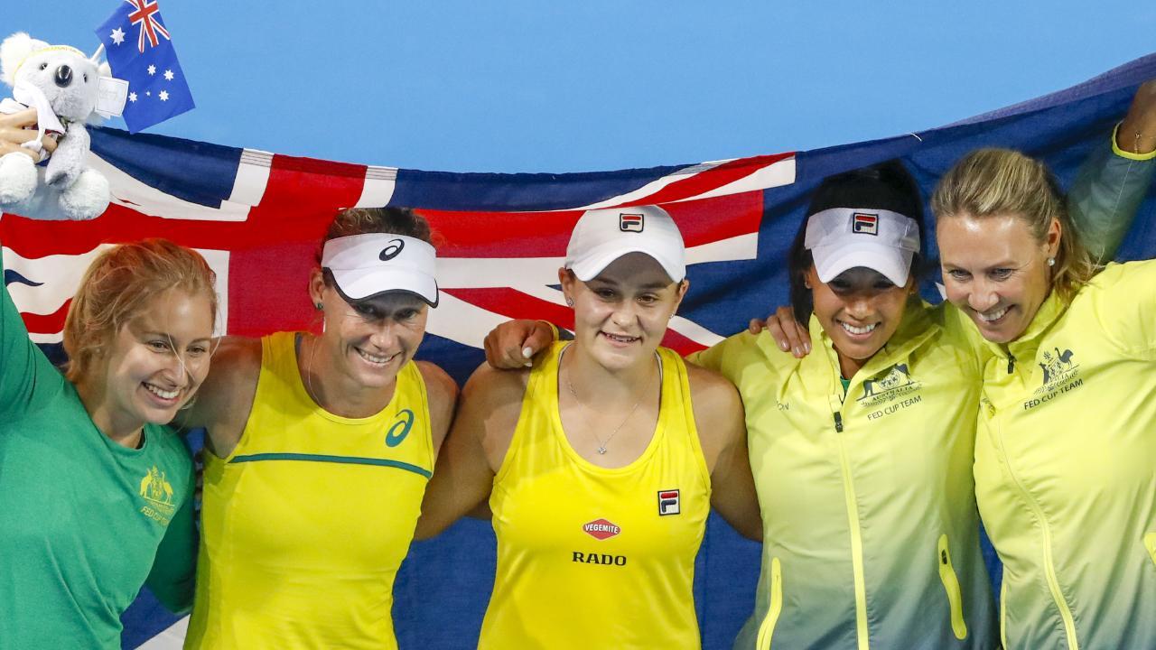 Daria Gavrilova, Sam Stosur, Ash Barty, Priscilla Hon and Alicia Molik celebrate their Fed Cup semi-final win against Belarus. Picture: AAP