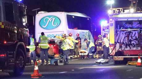 Three women are critical after a car crashed into the back of a bus. Picture: Damian Shaw