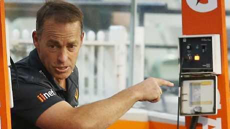 Alastair Clarkson talks to his players from the bench. Picture: Michael Klein