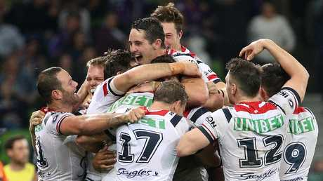 The Roosters celebrate their win over the Storm. Picture: AAP