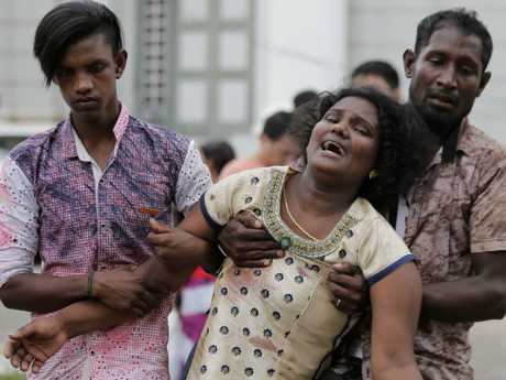 Relatives of a blast victim grieve outside a morgue in Colombo, Sri Lanka. More than 200 have been hundred were killed and hundreds more hospitalised. Picture: AP Photo
