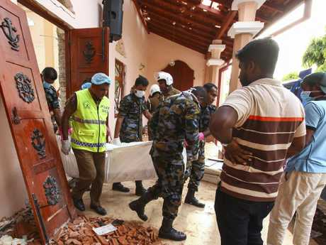 Sri Lankans carry a body at St. Sebastian's Church in Negombo, north of Colombo. Picture: AP Photo/Chamila Karunarathne