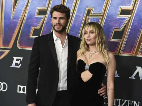 Liam Hemsworth, left, and Miley Cyrus arrive at the premiere of Avengers: Endgame.