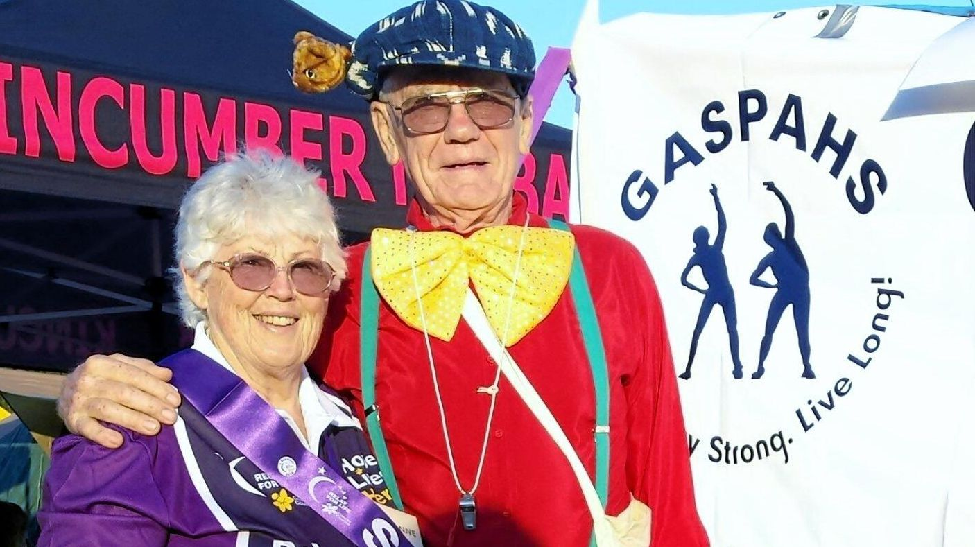 UNSTOPPABLE: Suzanne, a cancer survivor, and husband Russell Bridge at a recent Relay for Life event which Gwandalan and Summerland Point Active and Healthy Society (GASPAHS) members attended.
