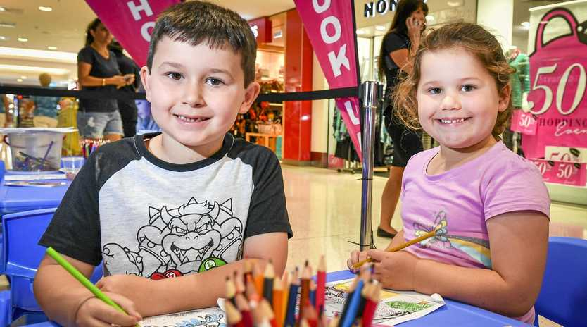 CREATIVE: Liam Loveday, 6, and Jemma Loveday, 4, took part in the Boyne Tannum HookUp colouring-in competition at Stockland during the school holidays.