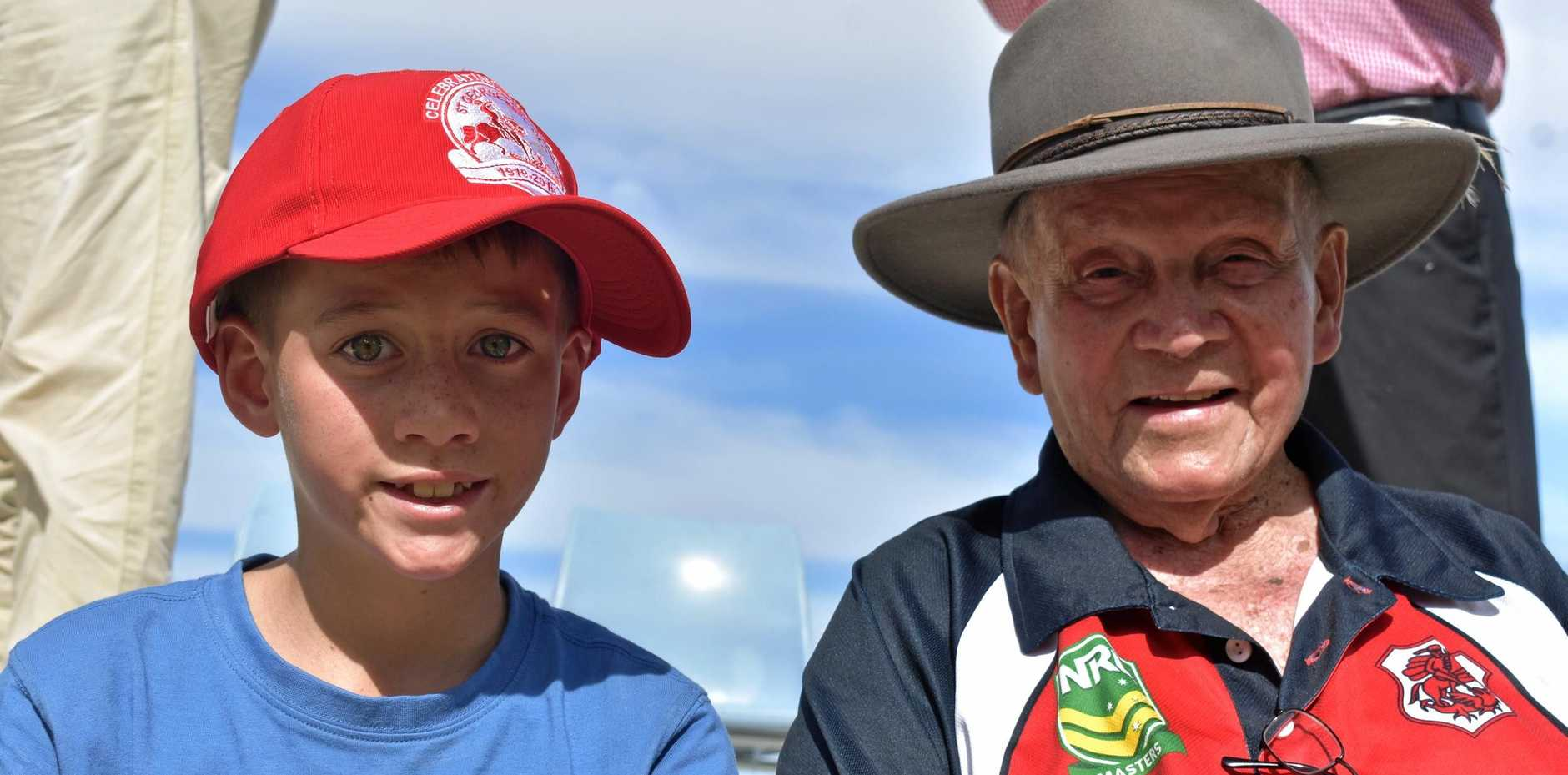 MILESTONE MARKED: Quade Howe, on behalf of his grandfather Stan (halfback), with Buddy 'Pop' Waters at the weekend's centenary celebrations.