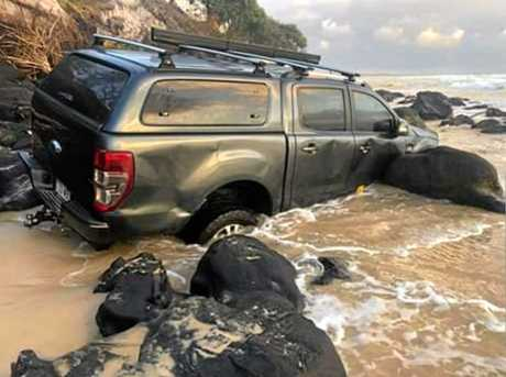The driver reportedly got stuck on Sunday night when trying to pass the rocks at mid-tide.