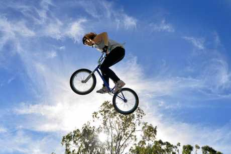 JUMPING TO GREAT HEIGHTS: Tannum Sands' BMX freestyle rider Natalya Diehm back in 2014. INSET: Diehm doing her thing at the 2019 UCI BMX Freestyle World Cup in Hiroshima.