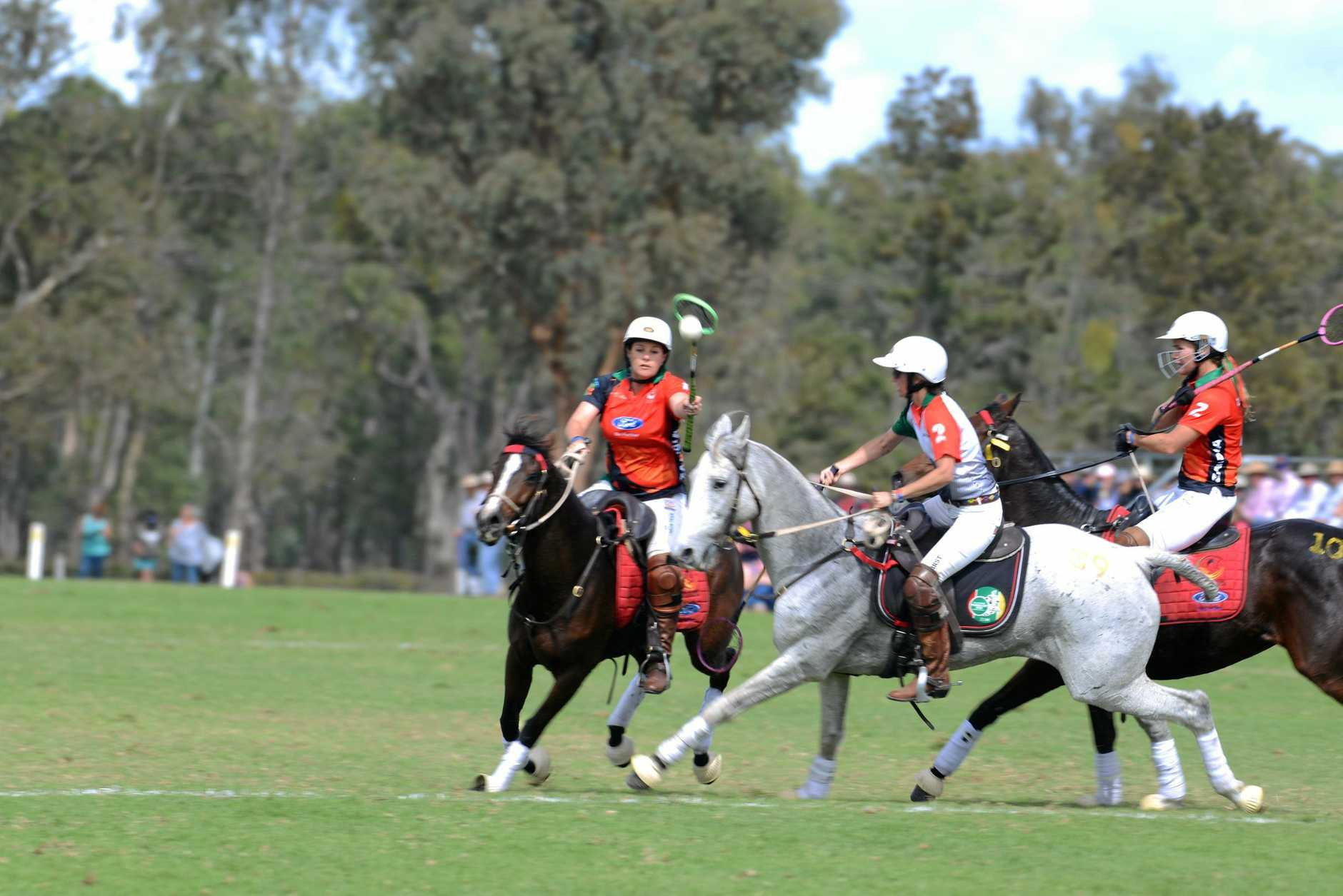 Kelly Krynauw (left) in possession for Zambia on day 2 of the Adina Polocrosse World Cup.