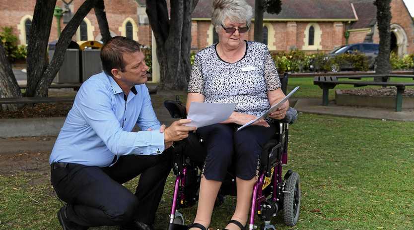PUSHING FOR HELP: Member for Bundaberg Dave Batt with Pat Allison.