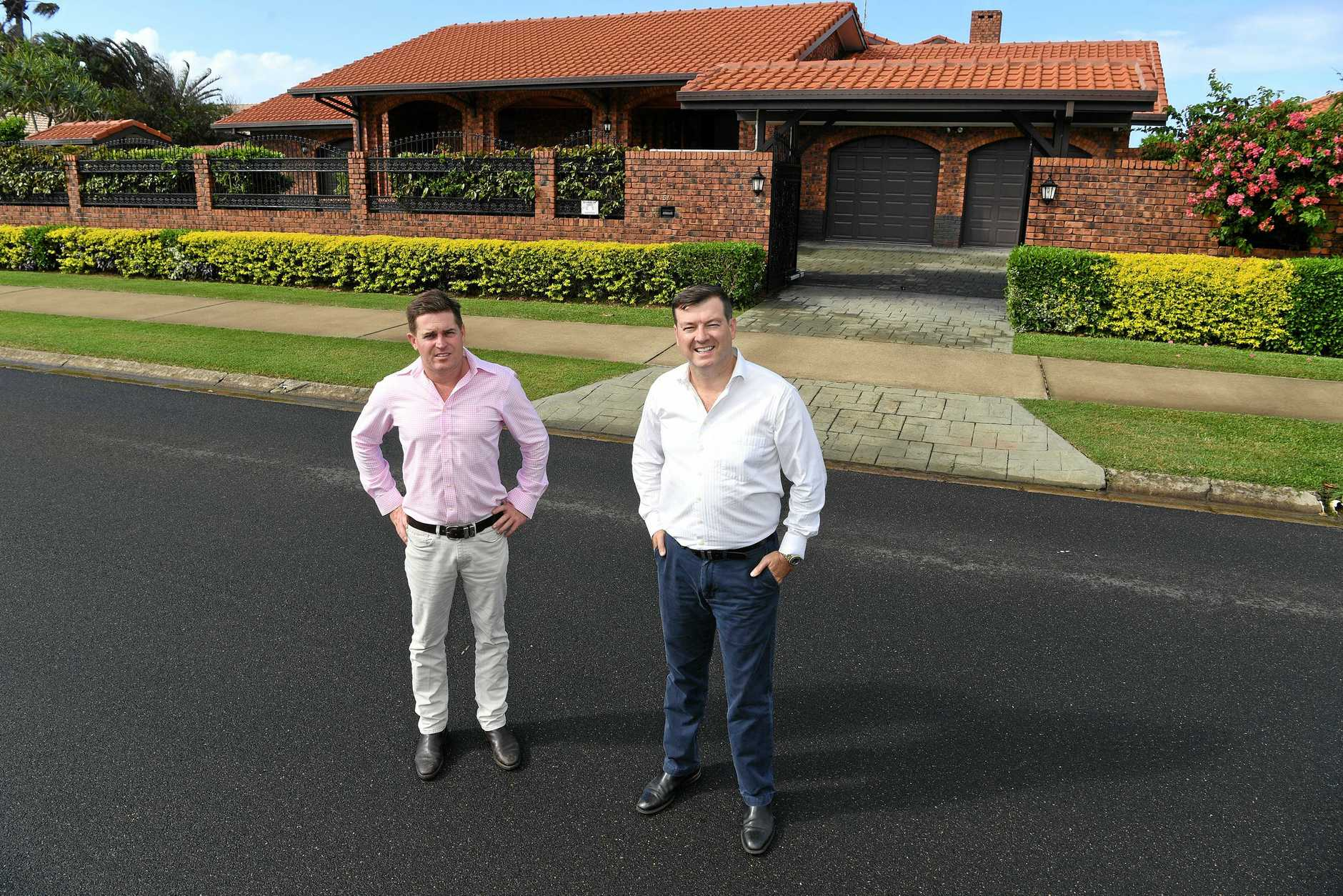 WATERFONT PROPERTY: Aaron Thompson and Scott Mackey outside 54 Barolin Esplanade Coral Cove.