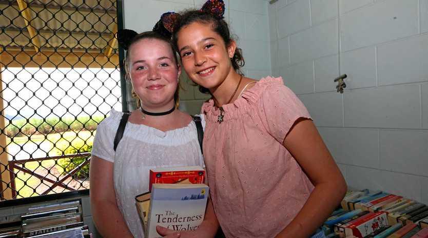 BOOKS: Ashley Warren and Scarlett Foti grab a bargain at last year's book bonanza.