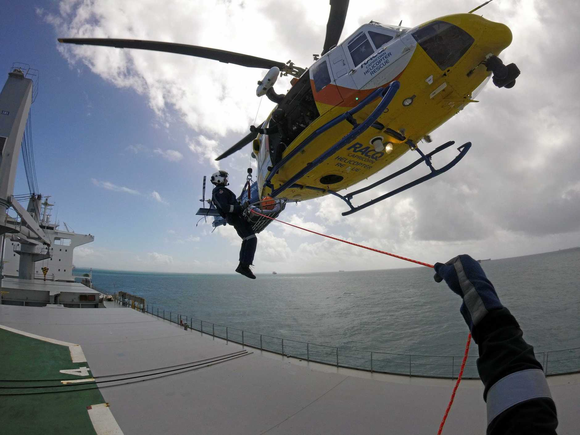 One person is in hospital after suffering severe abdominal pain on a ship anchored off the Gladstone coast.