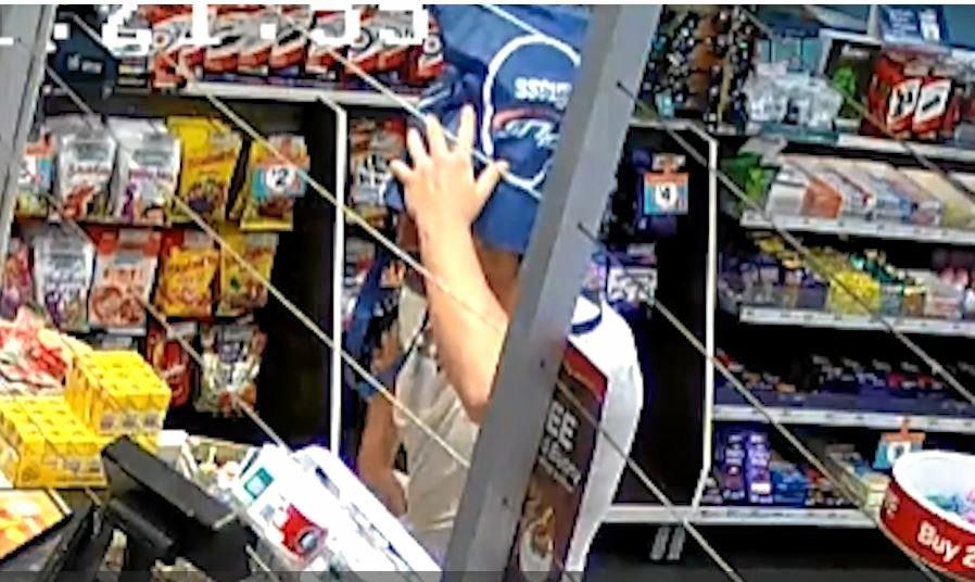 Police are searching for a man who robbed a service station with a recyclable shopping bag at Caboolture last night.