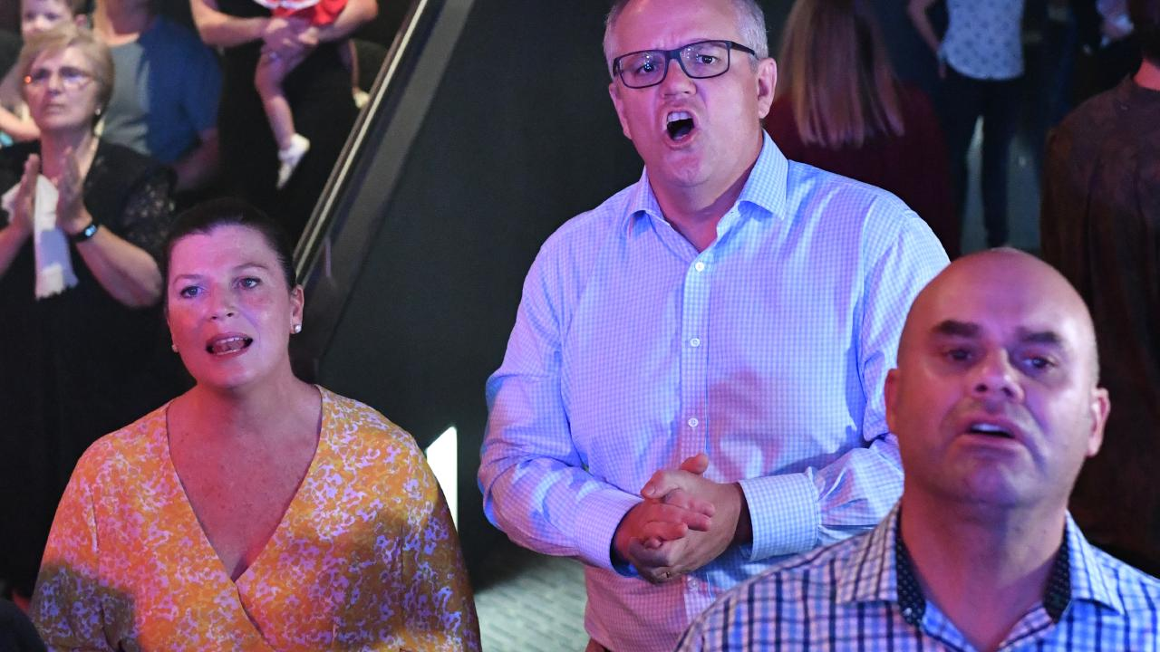 Prime Minister Scott Morrison and his wife Jenny singing. Picture: AAP