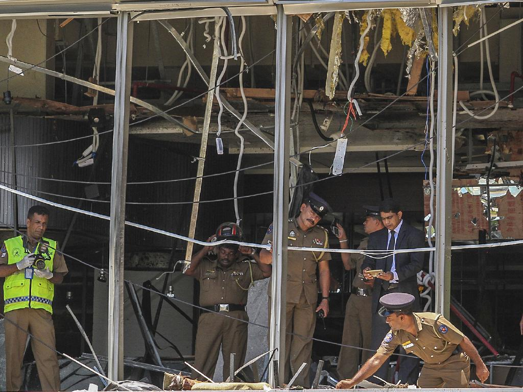 Sri Lankan Police officers inspect a blast spot at the Shangri-la hotel in Colombo, Sri Lanka where international tourists were killed by a terrorist bomb blast. Picture: AP Photo