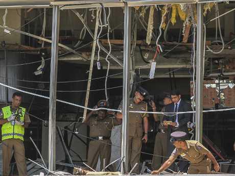 Sri Lankan Police officers inspect a blast spot at the Shangri-la hotel in Colombo, Sri Lanka where international tourists were killed by a terrorist bomb blast. Picture: AP Photo
