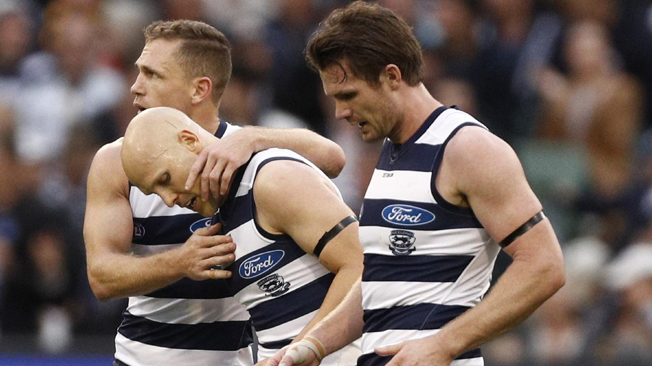 Gary Ablett with Joel Selwood and Patrick Dangerfield after kicking a goal. Picture: AAP