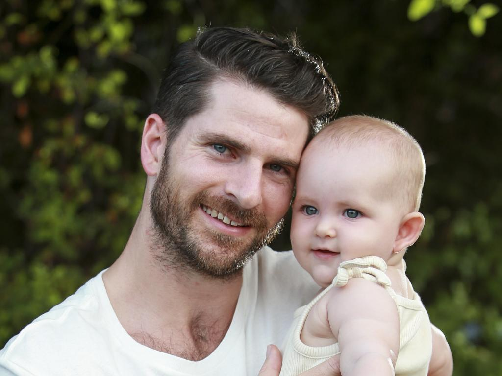 Dan Price, who has suffered depression, with his daughter Talulah at home in Bondi. Three million Australians are now reliant on antidepressants. Picture: Justin Lloyd.