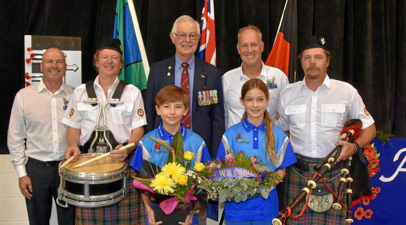 LEST WE FORGET: Richard Cass, Ivor Moulds, Dean Harlow, Rob Jennings, Rod Echague and school captains Noah Sue See and Emerson Copping at the school's Anzac assembly.