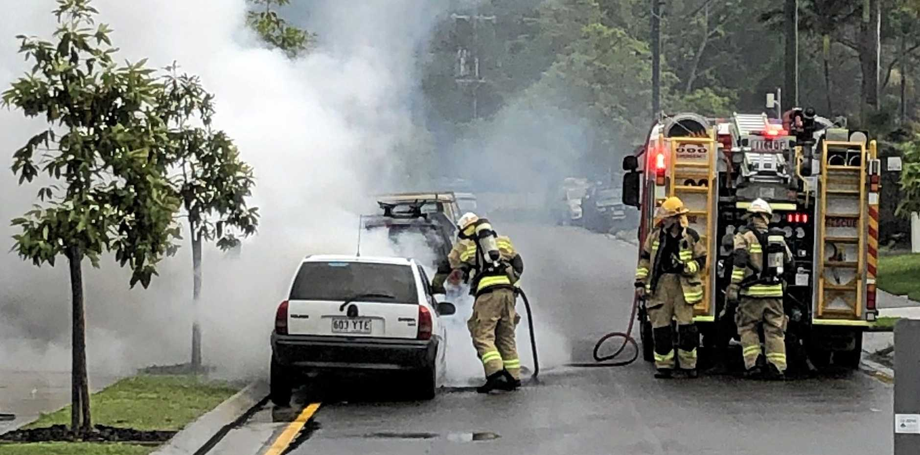 Firefighters saved a second car from being burned after the hatchback went up in flames at Buderim this morning.