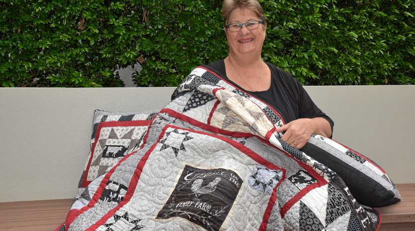 SEW IN LOVE: Barbara Underdown loves her new farm-themed quilt which she won from the Nanango Country Quilters and Craft Group's raffle for farmers.