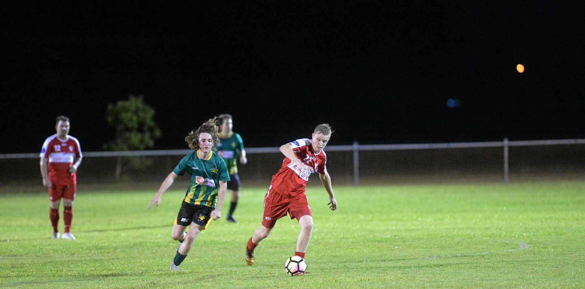 A STEP AHEAD: Wanderers' player Ryan Patton escapes Lions' Liam Carey in Round one of the FFA Cup at Wanderers Park.