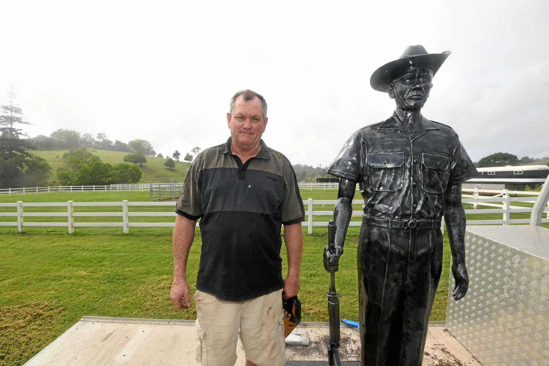 PROUD: Sculptor Dan Davie alongside his Vietnam War-era Australian soldier to be sent to Edmonton.
