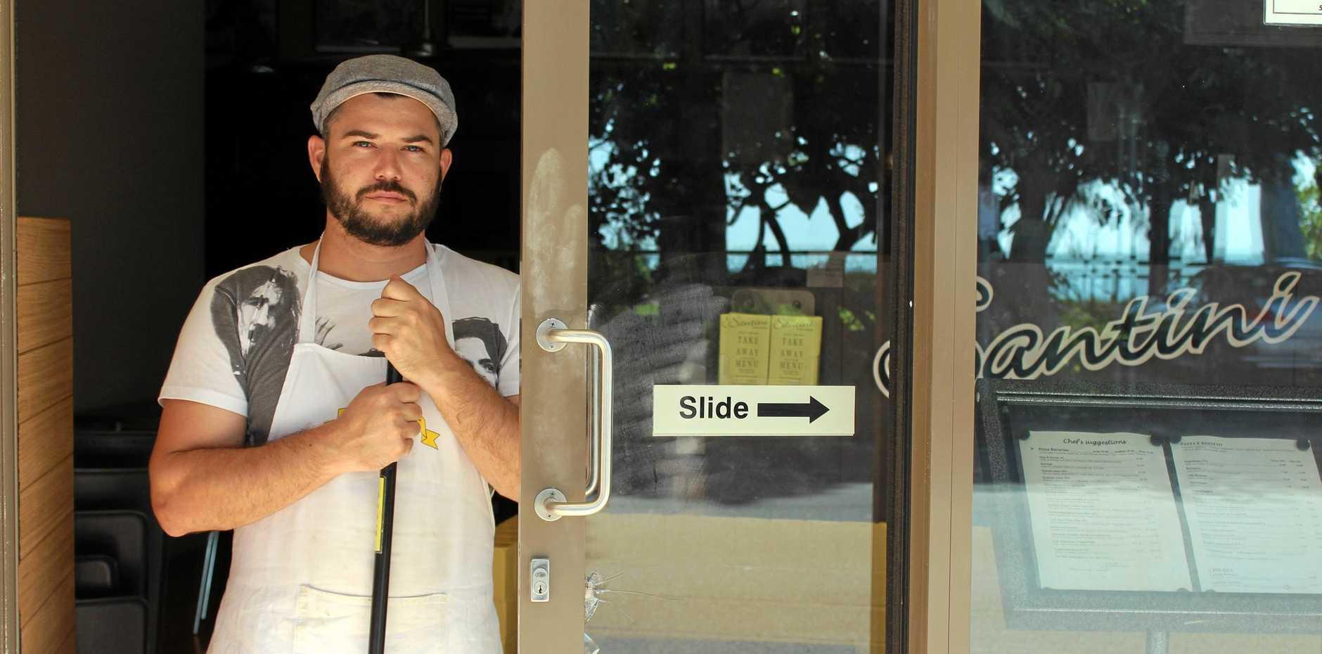 SENSELESS ACT: Santini Restaurant and Cafe staff member Leigh Steele spent Wednesday morning cleaning up after two men broke into the restaurant and ransacked the premises.