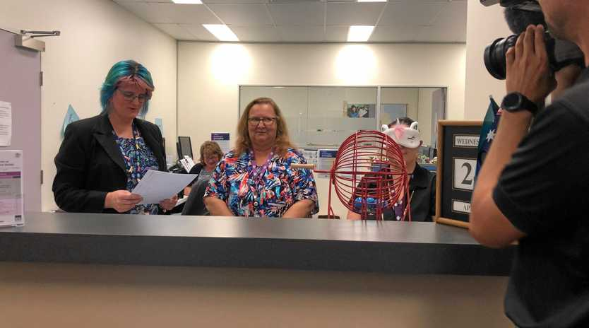 The staff at Maryborough's electorate office conducting the draw for the Wide Bay.