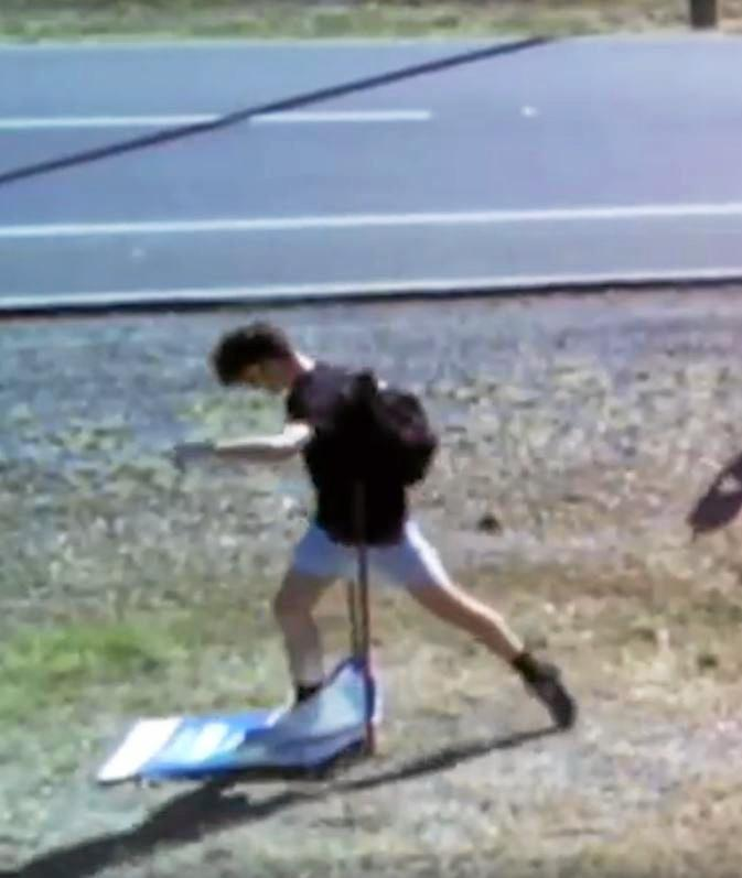 Footage showed a vandal destroying a Michelle Landry campaign sign on Gladstone Road