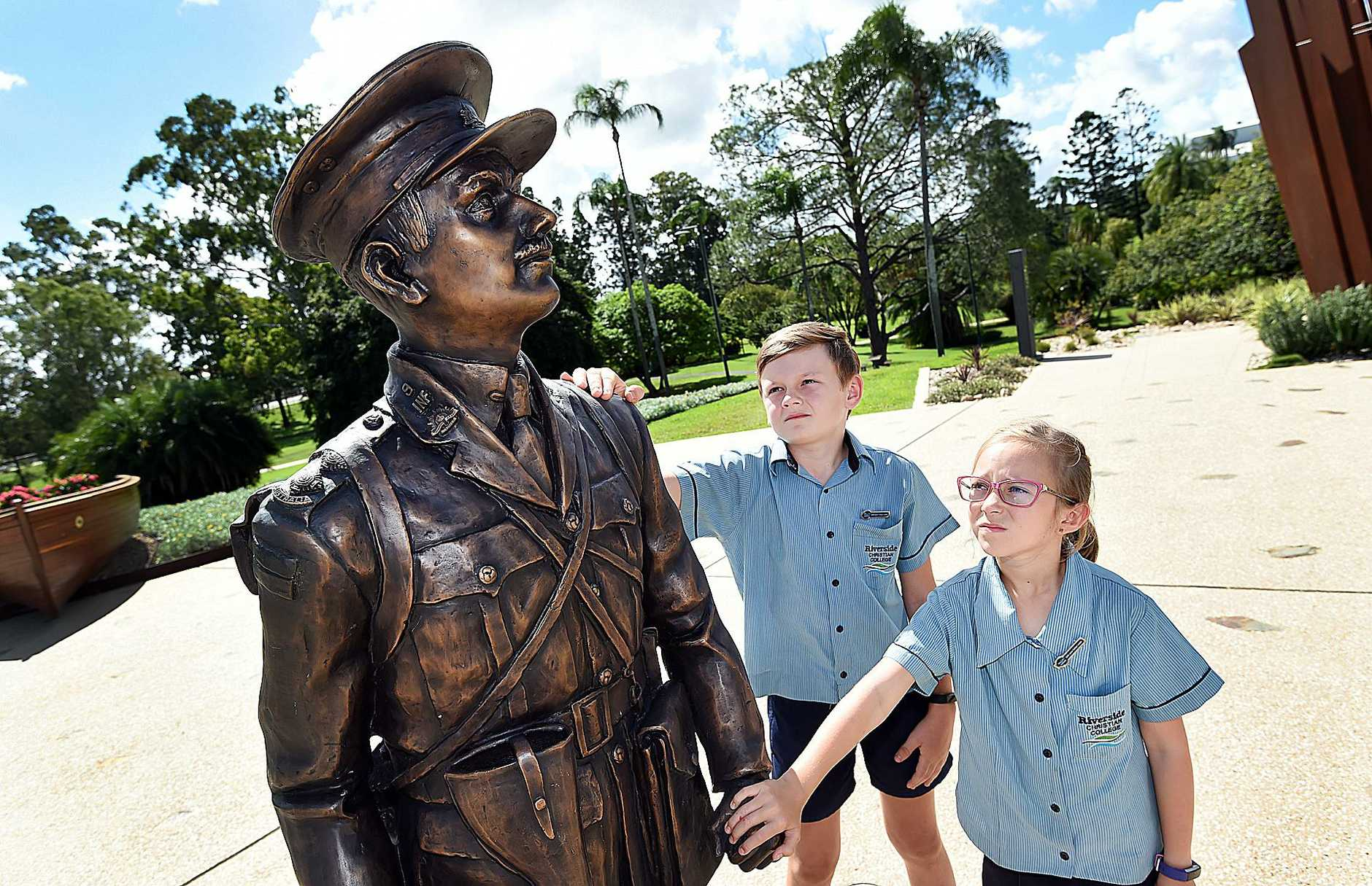 Riverside Christian College year 5 students Sean Hedberg and Mayana Friend at the Duncan Chapman Memorial in Maryborough.