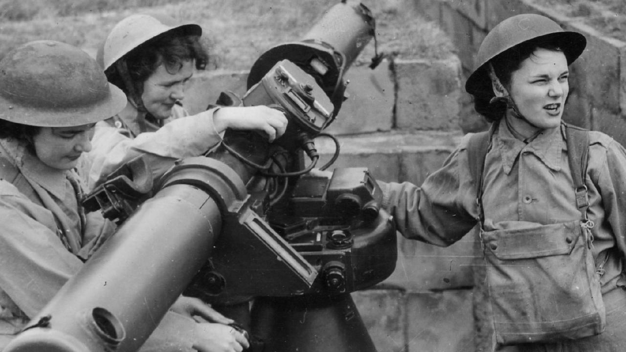 Australian women work on a height and rangefinder in 1942. Picture: News Corp Australia