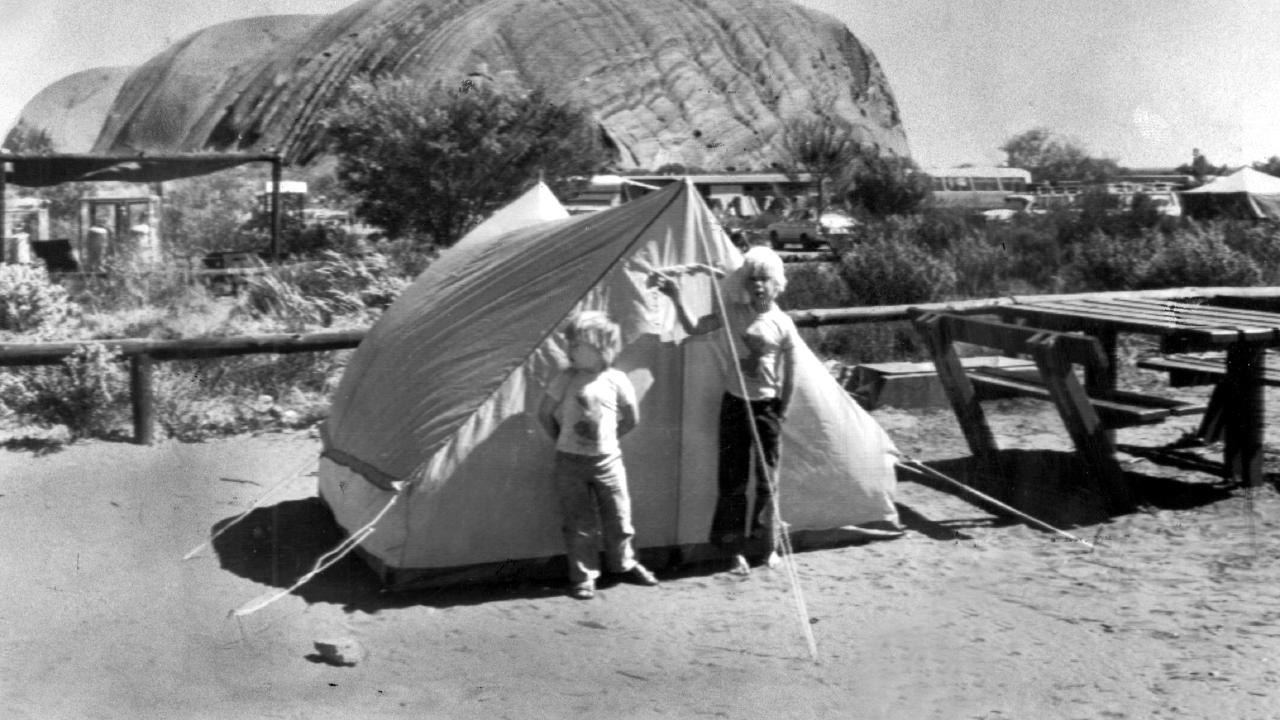 Michael and Lindy Chamberlain's sons Reagan (left) and Aidan outside the family tent at Uluru where their baby daughter Azaria was taken by a dingo.