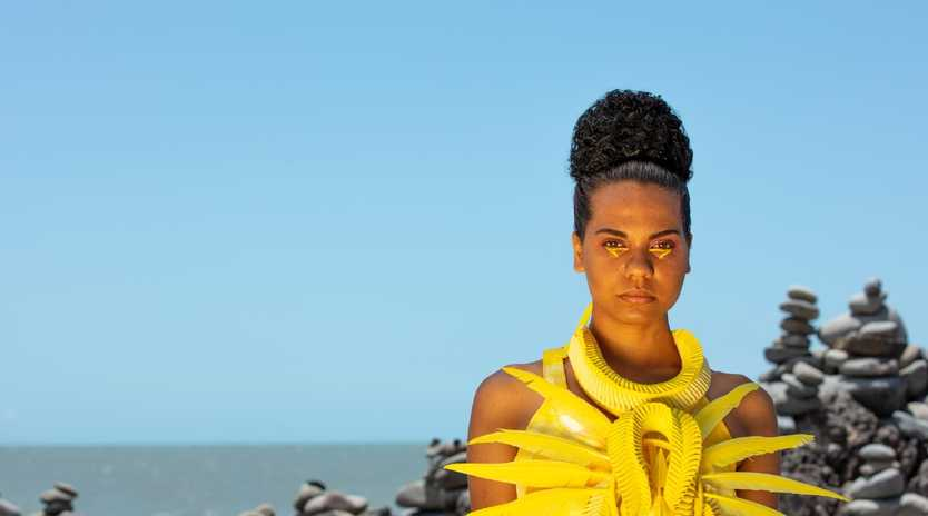 Ebony Awumpan Doyle of Cairns, wearing a woven neckpiece by artist Grace Lillian Lee, will participate in the 2019 Miss World Australia Queensland Preliminaries on the Gold Coast. Photo: Wade Lewis