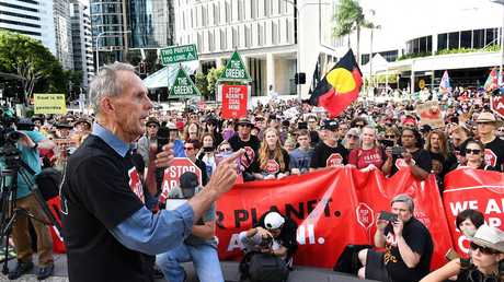 Conservationist and former Greens leader Bob Brown addresses protesters outside the Adani Headquarters in Brisbane. Picture: AAP Image/Dave Hunt