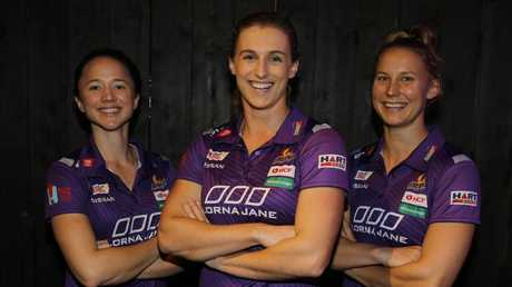 Queensland Firebirds Caitlyn Nevins, Gabi Simpson and Mahalia Cassidy. Picture: AAP/David Clark